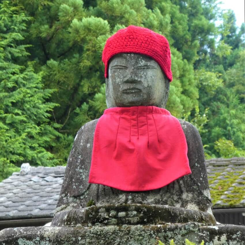 A Jizo statue with red clothes