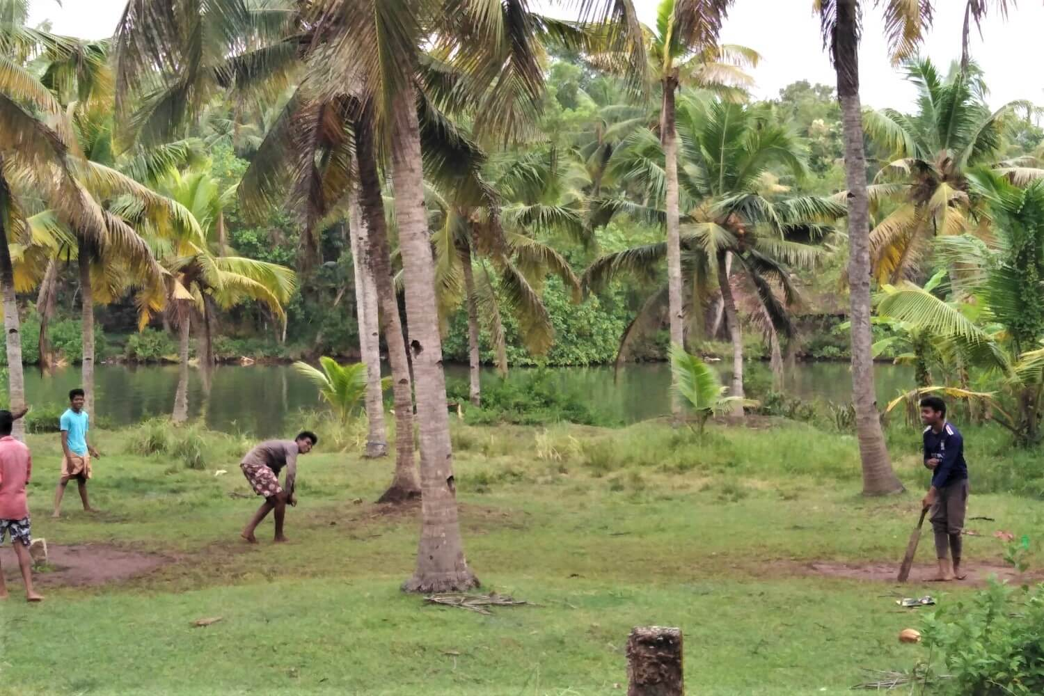 Locals playing Cricket at Munroe Island, India