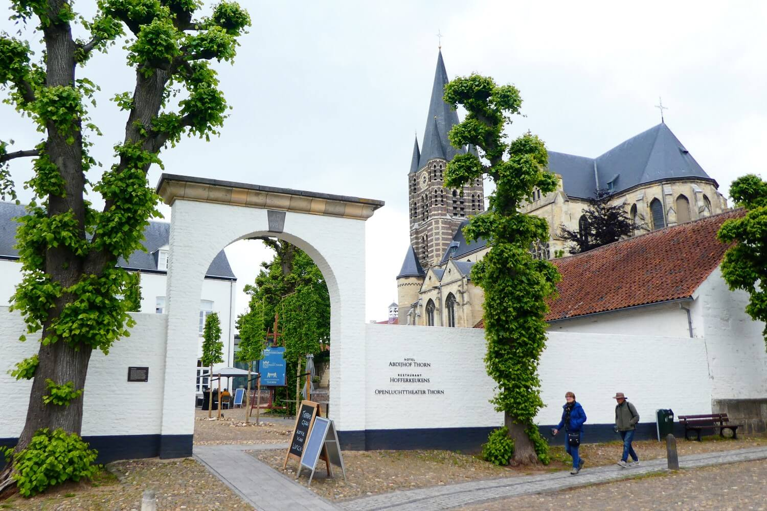 Restaurant and church in the white town of Thorn in Limburg